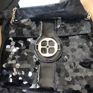 Black bag from Iman with Dust Cover